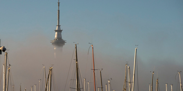 Loading The Sky Tower sits in a bed of fog on a cold winters morning as seen from Westhaven Marina. Photo / Jason Oxenham