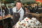 Guillermo Jose, a 39-year-old farmer from Spain, with meringues at London's Borough Market. Photo / Washington Post