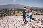 The Nomad Barber cuts hair on top of one of the pyramids at Teotihuacan in Mexico. Photo / Facebook, Nomad Barber