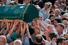Mourners in Istanbul's Basaksehir neighbourhood carry the coffin of Muhammed Eymen Demirci, killed during the attacks on Ataturk International Airport. Photo / AP