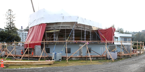 Scaffolding and protective sheeting dominates the under renovation conference centre in Napier. Photo / Duncan Brown