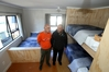 GOODBYE HOMELESSNESS: Project manager Michael Wiltshire and Minister Te Ururoa Flavell in one of the bedrooms at Whare Tauranga, which can sleep six people. PHOTO/JOHN BORREN
