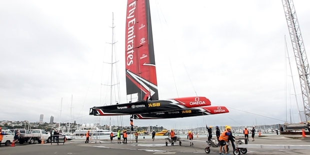 Emirates Team New Zealand launch the first of their America's Cup test boats at their new base in Auckland. Photo / Michael Craig