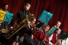 John Paul College's Jasper Boone played the baritone saxophone during their Rhapsody Rotorua performance to musical director Rodger Fox yesterday. Photo / Ben Fraser