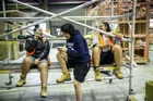From left, Juliane Pesamino, Lauryn Apelu, 16, and Grace Nas-Gaitu, 16, from Kelston Girls College, are at Unitec learning the trades. Photo / Michael Craig