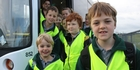 EASILY SEEN: Olivia Weir, 8 (far left) ready to go home from school with other Fernridge School pupils wearing their new high-vis vests. Wairarapa Road Safety Council projects co-ordinator Holly McGeorge (middle) explains how to best use them.PHOTOS/EMILY NORMAN