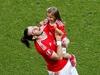 Gareth Bale celebrates Wales' win with daughter Alba. Photo / AP
