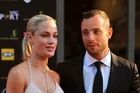 Reeva Steenkamp and Oscar Pistorius in 2013. Picture / AP