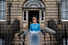 First Minister Nicola Sturgeon speaks to the media outside Bute House in Edinburgh, Scotland. Photo / AP