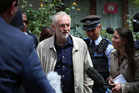 Labour Party leader Jeremy Corbyn faces the media as he leaves his house in London. Photo / AP