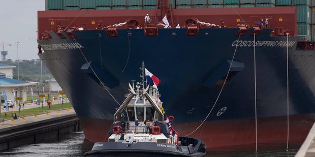 A tugboat leads to the Neopanamax cargo ship, Cosco Shipping Panama, as it approaches the new Agua Clara locks, near the port city of Colon, Panama. Photo / AP