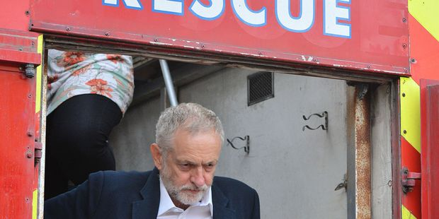Britain's Labour Party leader Jeremy Corbyn leaves after speaking to supporters in Parliament Square, London. Photo / AP