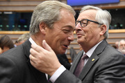 European Commission President Jean-Claude Juncker, right, greets UKIP leader Nigel Farage during a special session of European Parliament in Brussels. Photo / AP