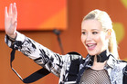 Singer Iggy Azalea says she left her fiancé Nick Young after catching him cheating on home security camera footage. Photo/AP