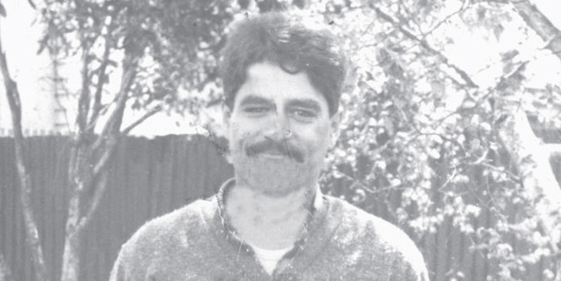 Peter Joseph Holdem seen in a photo taken on the day of his arrest for the murder of Louisa Damodran in 1986. Photo / File
