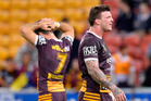 Ben Hunt and Josh McGuire of the Broncos are dejected after their team loses the round 17 NRL match. Photo / Getty Images.