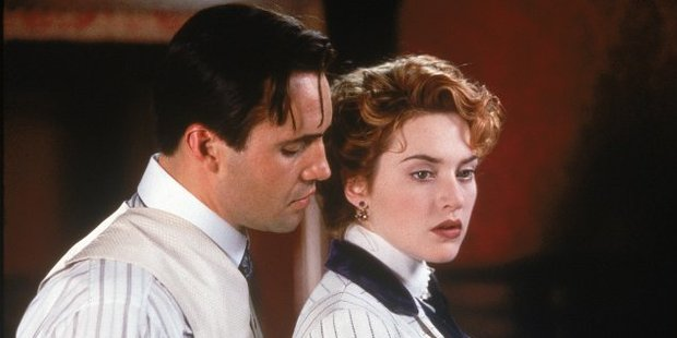 Billy Zane as Cal Hockley and Kate Winslet as Rose from the 1997 Titanic.