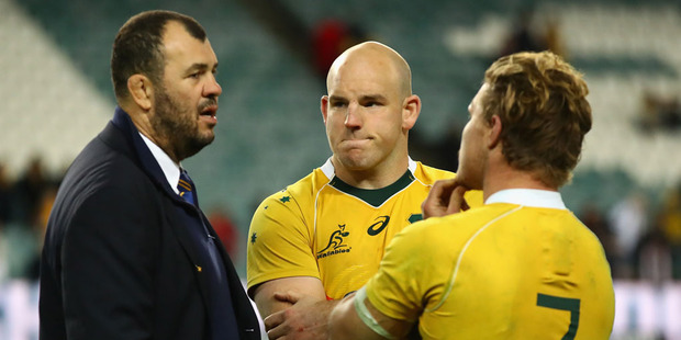 Wallabies coach Michael Cheika, captain Stephen Moore and Michael Hooper of the Wallabies talk after losing. Photo / Getty Images.