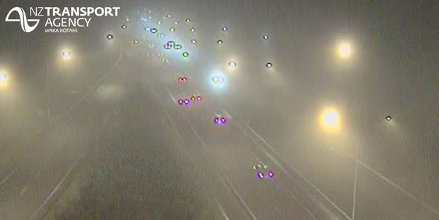 Motorists were warned to take care as fog blanketed the motorway this morning. Photo / NZTA