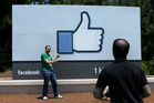 Visitors outside Facebook's California HQ. Facebook's updated its algorithm to favour posts from friends and family. Photo / AP
