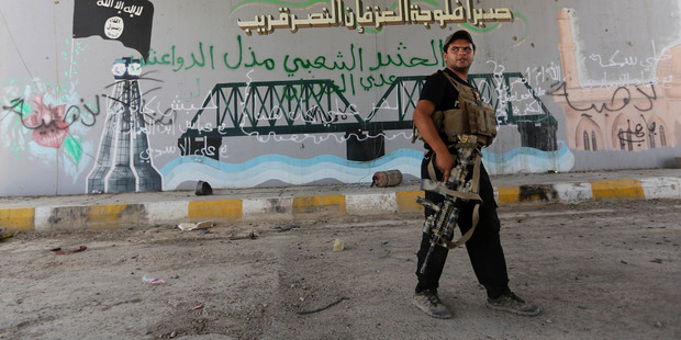 A member with Iraqi counter-terrorism forces patrols Fallujah, Iraq. Photo / AP
