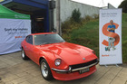 The boss' sweet ride - a 1972 240Z - a rare example of a car that has actually gone up in value.