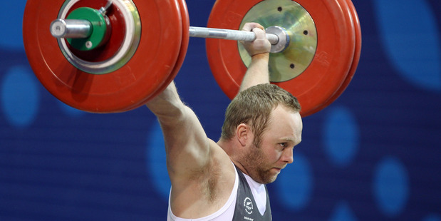 Richie Patterson of New Zealand in action in the 85kg men's weightlifting event. Photo / Getty