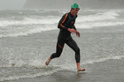 Kane Radford leaves the water in the King of the Bays Ocean Swim at Takapuna Beach. Photo / Getty