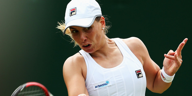 Marina Erakovic plays a forehand during her Wimbledon first round match in 2015. Photo / Getty Images