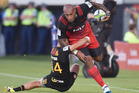 Nemani Nadolo of the Crusaders is tackled by Shaun Stevenson of the Chiefs during their round one Super Rugby match. Photo / Getty