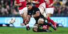 Jerome Kaino of the All Blacks chases down a ball against Luke Charteris of Wales during an International Test match. Photo / Getty
