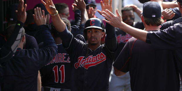 Francisco Lindor celebrates with teammates in the dugout after scoring. Photo / Getty Images