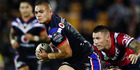 Tuimoala Lolohea of the Warriors beats the tackle from Shaun Kenny-Dowall of the Roosters during their round 15 NRL match. Photo / Getty