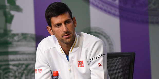 Novak Djokovic speaks to the media during a press conference prior to Wimbledon. Photo / Getty Images