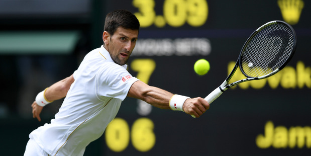 Novak Djokovic plays a backhand during the first round of Wimbledon. Photo / Getty Images