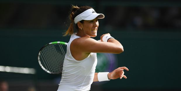 Gabrine Muguruza plays a forehand shot during her Wimbledon first round match. Photo / Getty Images
