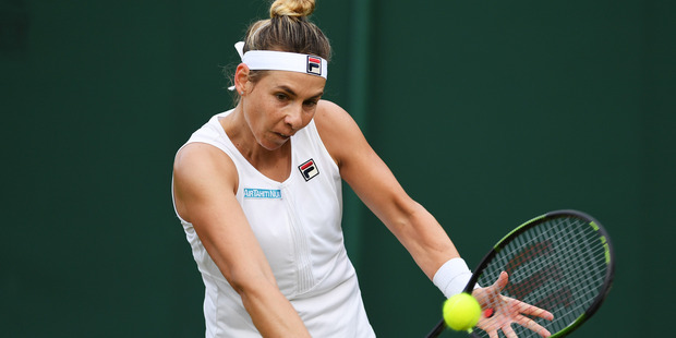 Marina Erakovic plays a backhand shot during her first round match against Irina Falconi. Photo / Getty Images