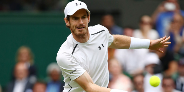 Andy Murray plays a forehand during his first round match against Liam Broady. Photo / Getty Images