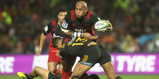 Nemani Nadolo of the Crusaders is tackled by Seta Tamanivalu of the Chiefs. Photo / Getty