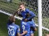 France's Antoine Griezmann, top, celebrates scoring the second goal. Photo / AP