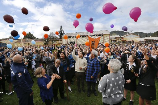 Whangarei Girls' High School students release balloons with positive affirmations attached to them. Photo / John Stone