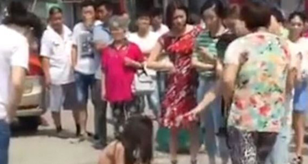 One onlooker tries to intervene, but the women ignore her. Photo / YouTube