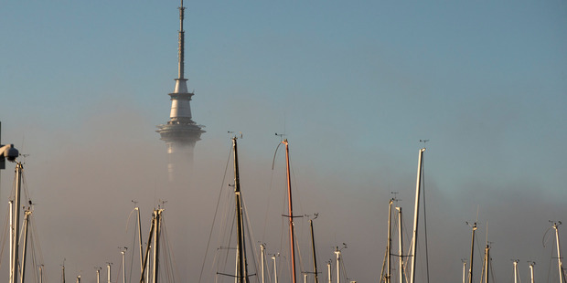 The Sky Tower sits in a bed of fog this morning. Photo / Jason Oxenham