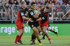 Anton Lienert-Brown of the Chiefs is tackled by Andy Ellis (L) and David Havili of the Crusaders during the round one Super Rugby match. Photo / Getty Images