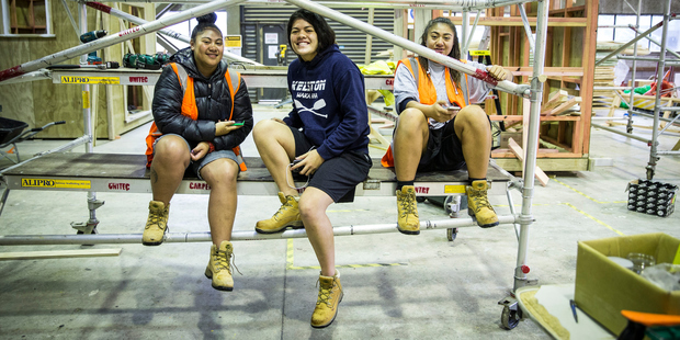 Loading From left, Juliane Pesamino, Lauryn Apelu, 16, and Grace Nas-Gaitu, 16, from Kelston Girls College, are at Unitec learning the trades. Photo / Michael Craig