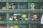 Post-it note declaration of war. The colourful challenge going on between the Zurich Building and HSBC House in downtown Auckland. Photo / Nick Reed