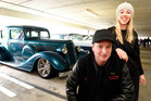 Jeremy Michael Nagle and Tanya Swain stand next to Mr Nagle's 1935 Buick which has a fuel-injected smallblock and airbag suspension. Photo / George Novak