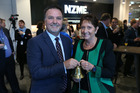 NZME's Chief Executive Michael Boggs and Carol Campbell 'ring the bell' as NZME lists on the NZX in the wake of Brexit. Photo / Greg Bowker