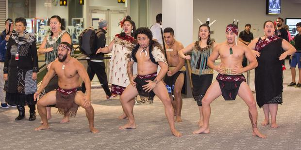 Cultural performers farewell and welcome the flight. Photo / Winston Aldworth