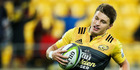 Beauden Barrett of the Hurricanes in action.